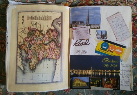 My travel journal with post cards and vintage maps